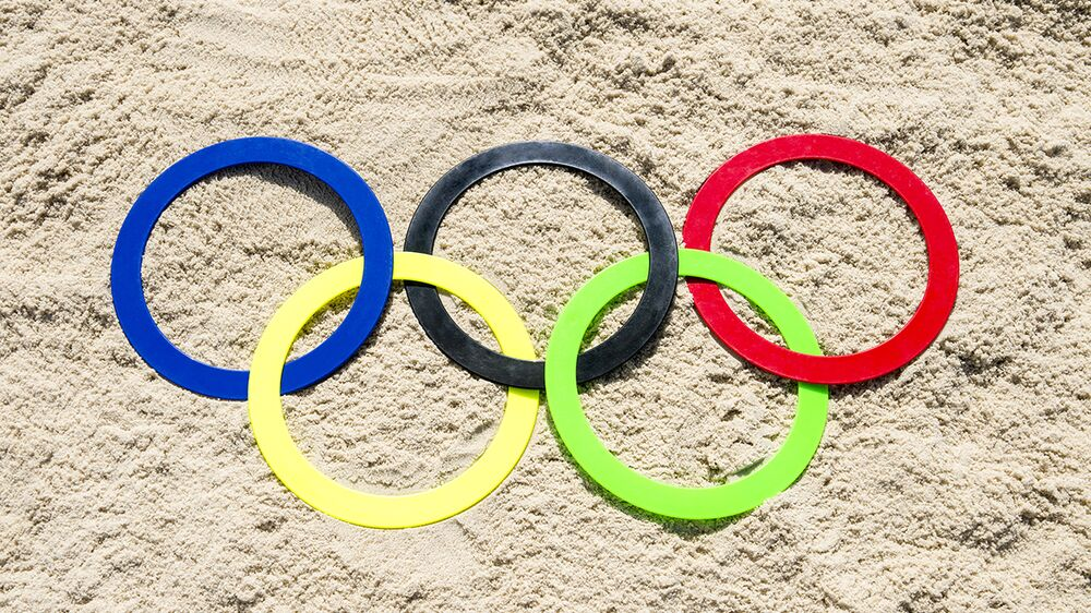 Olympic rings in sand