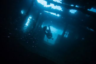 Scuba Diver Underwater Safely Exiting a Wreck