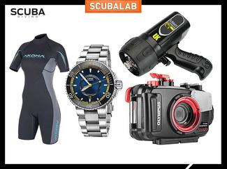 New scuba diving gear. Wetsuit, dive watch, underwater camera, and dive light.