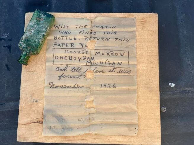 Woman Finds 96 Year Old Message In Bottle While Diving Scuba Diving