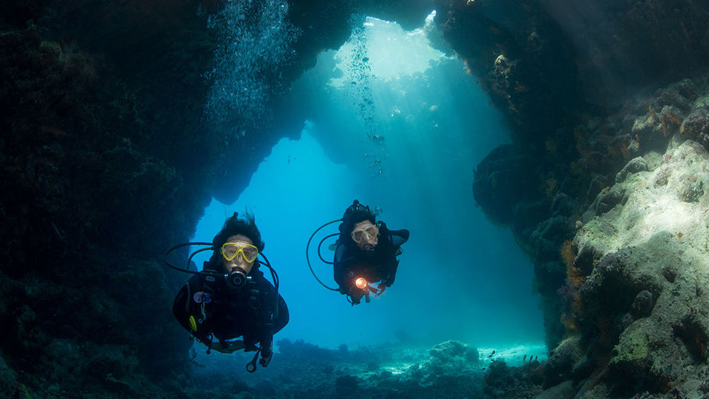 Scuba Divers In The Red Sea, Egypt