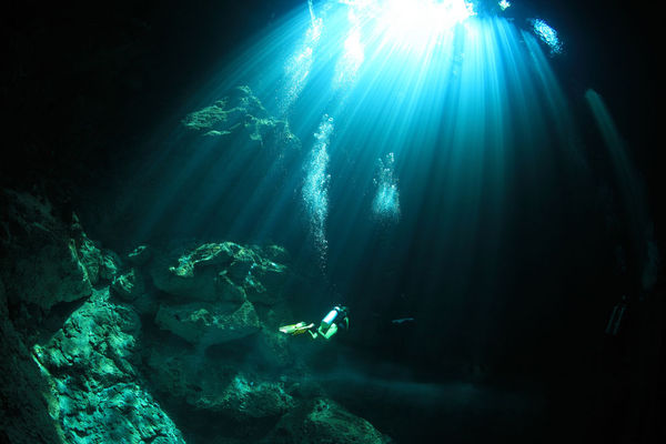 Underwater Photo Diver in Cenote in Mexico