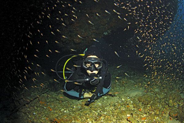 Scuba Diver Underwater at Night