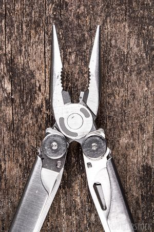 Multi-tool for scuba diving save-a-dive kit